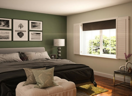 white shutters with blackout blinds in a bedroom