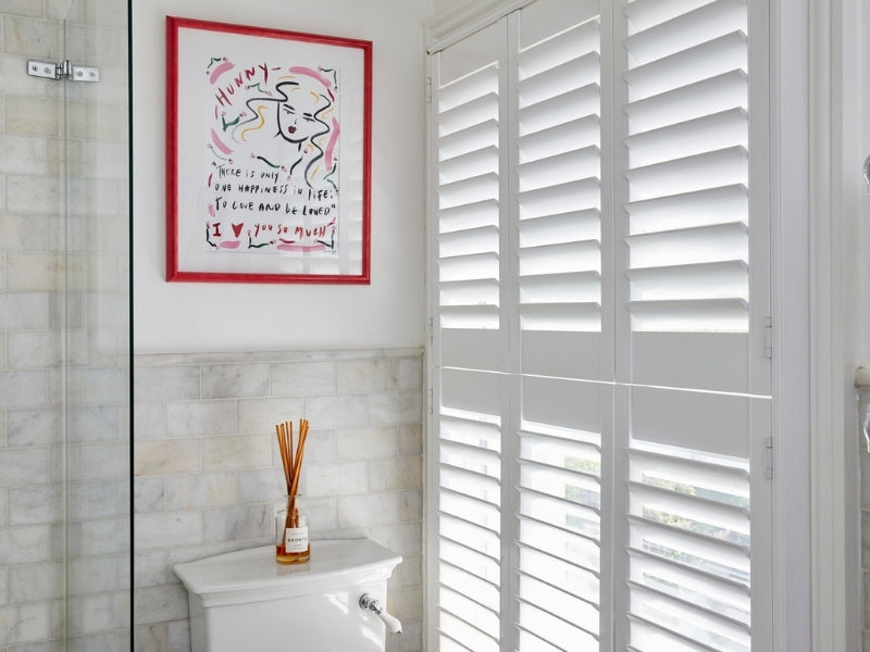 bathroom with closed shutters