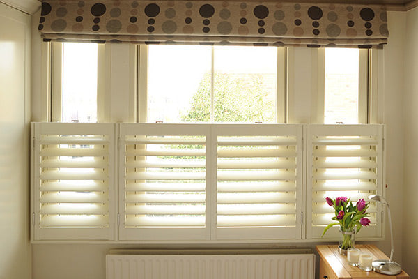 window with cafe style shutters letting the light in