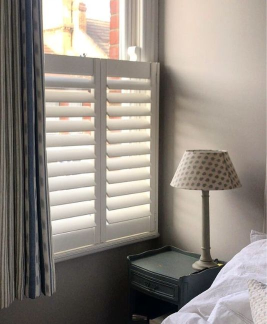 cafe shutters in a bedroom with curtains