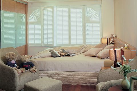 pastel colour bedroom with matching wooden shutters