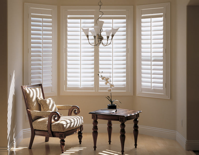 lights entering through half open louvres of bay window shutters