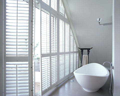 white shutters in a bathroom
