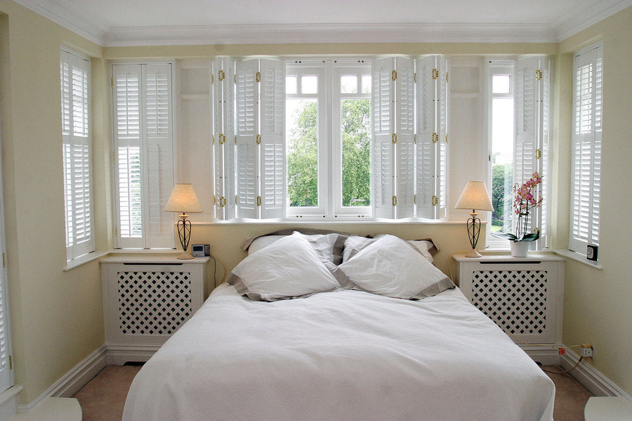 bedroom with white shutters inside mounting option