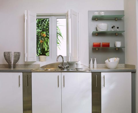 white kitchen with white solid panel shutters on the window