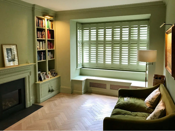 perfect dressing for a bay window with green shutters blending with the surrounding colours