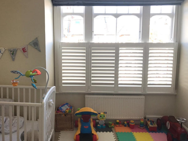 window with half height shutters in a nursery room in Chiswick London