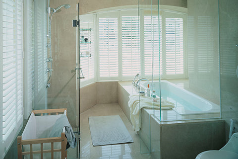 bathroom window treatment ideas bathtub in a bay window with plantation shutters