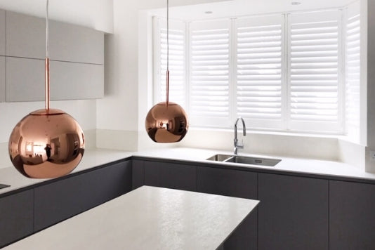 modern kitchen with white shutters