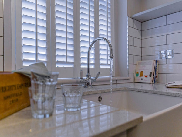 kitchen sink with waterproof shutters on the window, design by Nicola Burt
