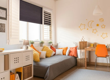 orange bedroom with integrated darkering blinds an window shutters