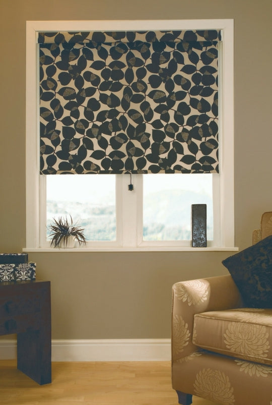 window covered with a lowered roman blind with beige and brown floral pattern