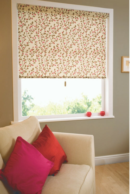 large windows with half open white roman blinds with a floral pattern