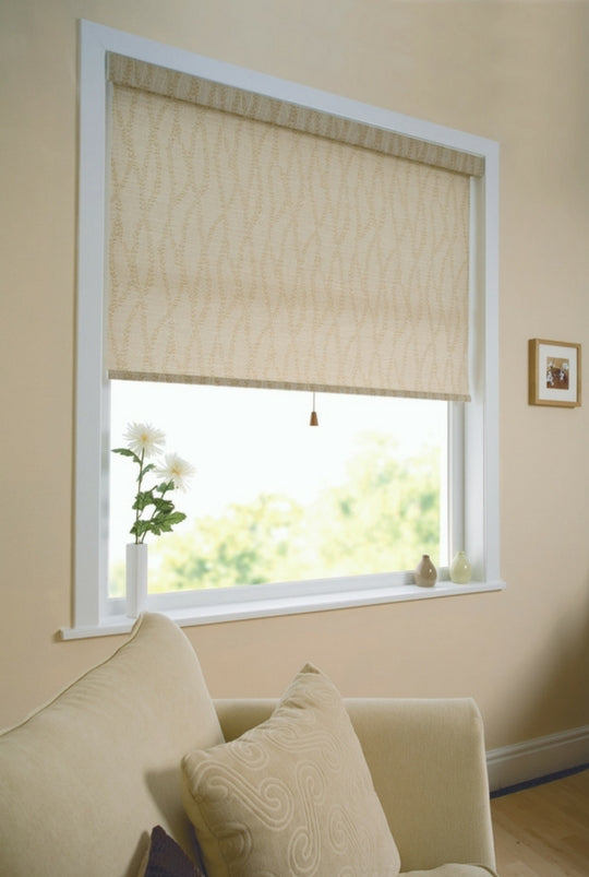 large window with half raise beige roman blind matching the decor of the cushion on the white sofa