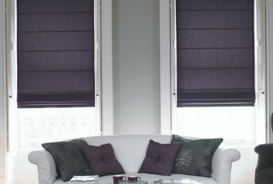 large windows with half open white venetian blinds