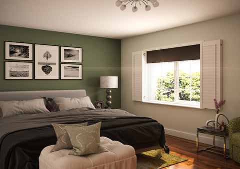 bedroom with green wall open shutters and blackout blinds