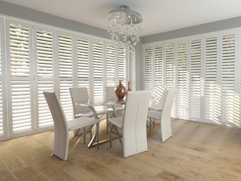 large dining room with shutters on two sides of the room