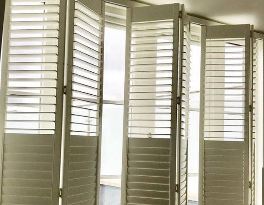 sliding plantation shutters with split louvres