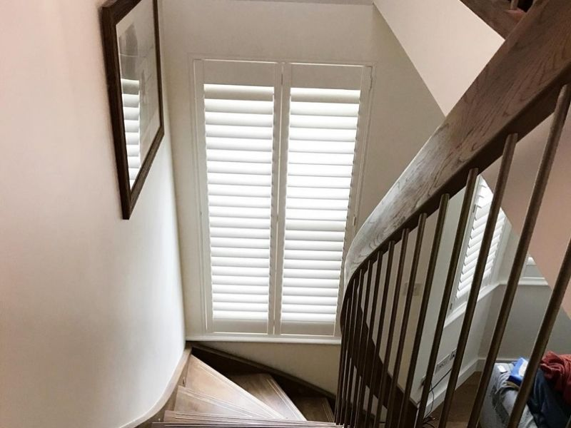 staircase window with closed shutters
