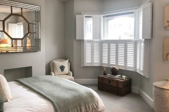 bedroom with tier on tier shutters, bottom closed and top open