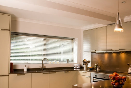 modern kitchen with venetian blinds on the window