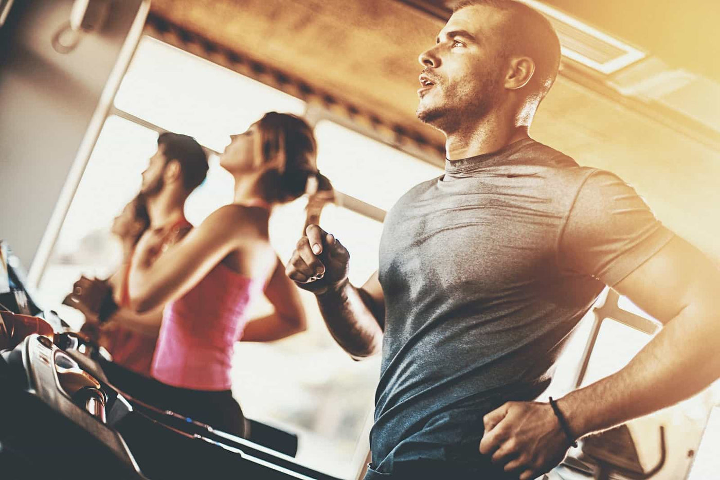 Sweating man running on treadmill