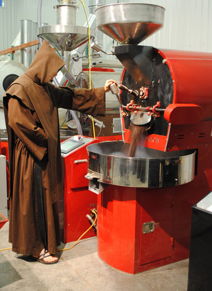 A Monk roasting Mystic Monk Coffee beans to be sold online.