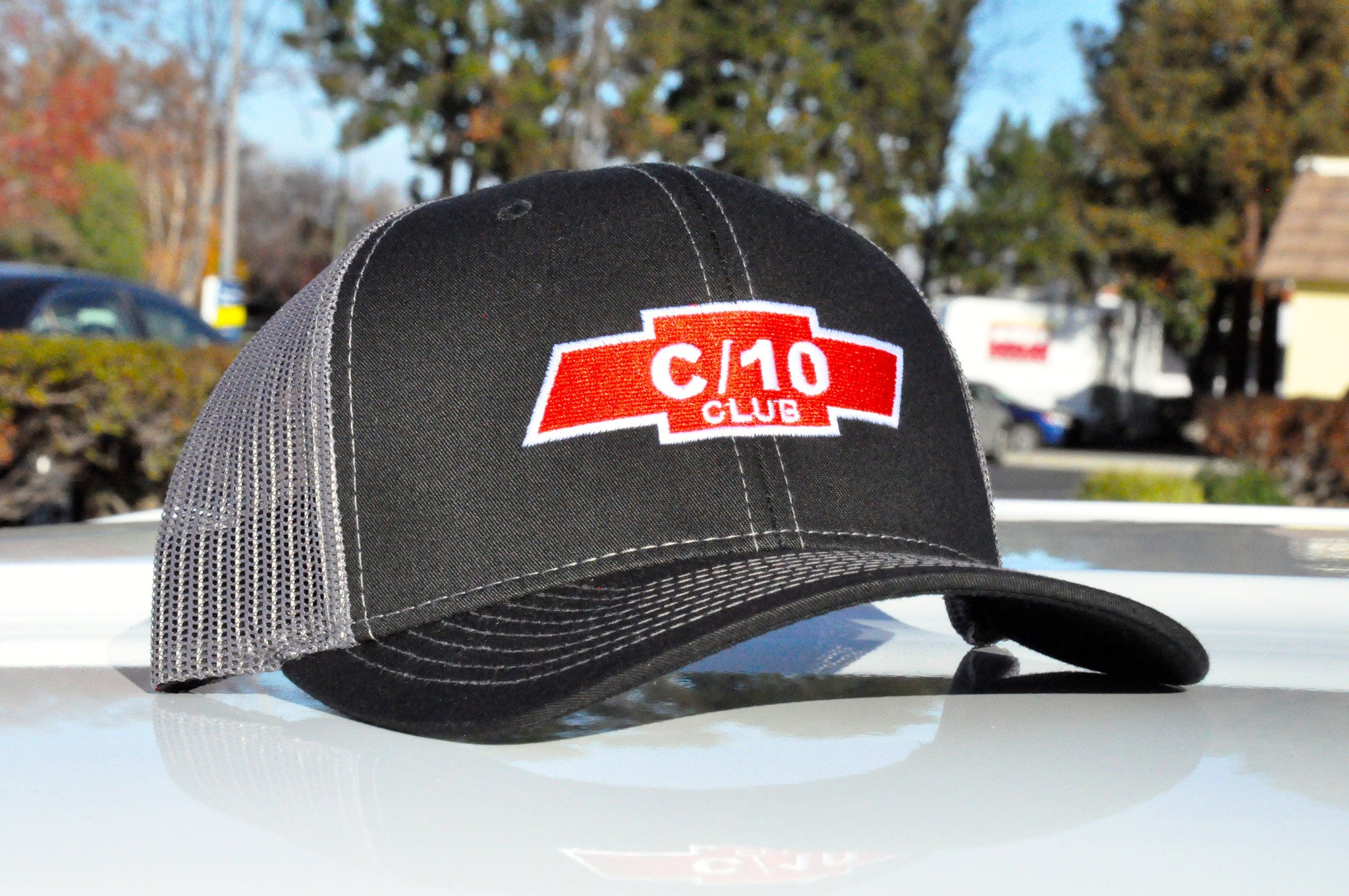 black and grey c10 club apparel trucker hat