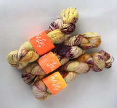 Sexiest Of Them All - Asteria: 75% Superwash Merino 20% Nylon 5% Gold Stellina - Sock