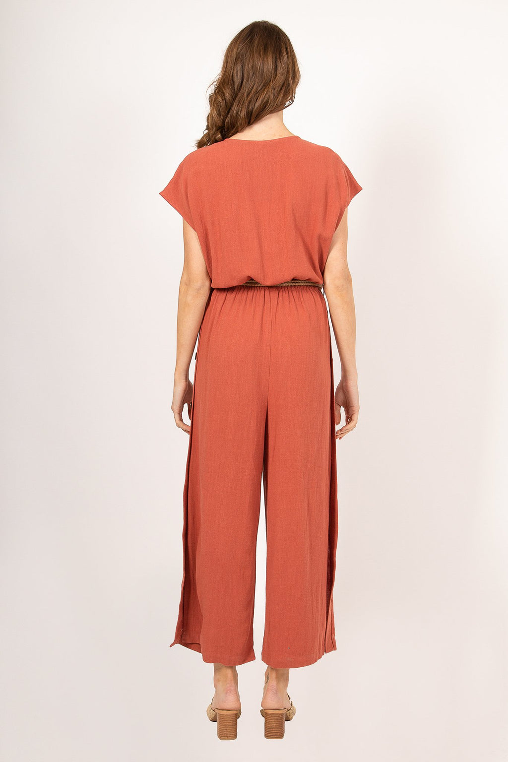 JUMPSUIT FEATURING A THIN ROPE BELT AND BUTTON SOWN SIDE SLITS