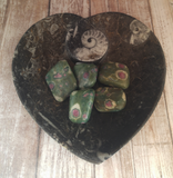 Fossil heart plate with ruby zoisite tumbled pieces