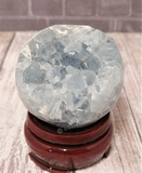 Celestite Sphere on wood stand natural blue gemstone