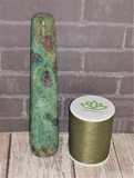 Ruby Zoisite wand from India with thread spool size reference