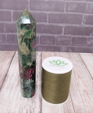 Ruby Fushite Zoisite Obelisk with thread spool size reference