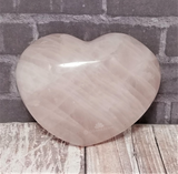 Rose Quartz Heart on Wood Grain and brick Background GGandJ.com Gypsy Gems & Jewelry Naturally Unique