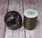 Rhodonite Sphere with thread spool size reference