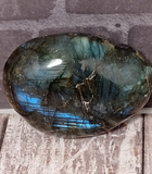 Iridescent gemstone gallet on wood grain background Labradorite from Madagascar GGandJ.com