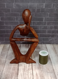 Abstract person statue with thread spool size reference
