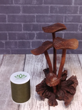 small mushroom wood statue with thread spool size reference