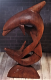 Dolphin duo carved from wood
