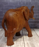 Rear view of hand carved wood elephant