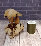 Mushroom statue with thread spool size reference