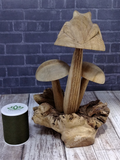 Back side wood frog on mushroom with thread spool size reference
