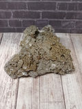 Large piece of rough pyrite on quartz gemstone mineral