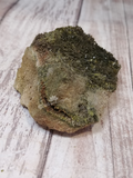 Side view of Epidote on Quartz