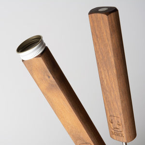 Magnets in the bases of the handles for your Social Set hold our steel caps, allowing you to turn most plastic bottles into targets with the roasting sticks planted in the ground