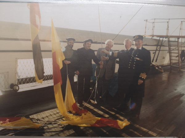 Hoisting the code and signal flags HMS Warrior