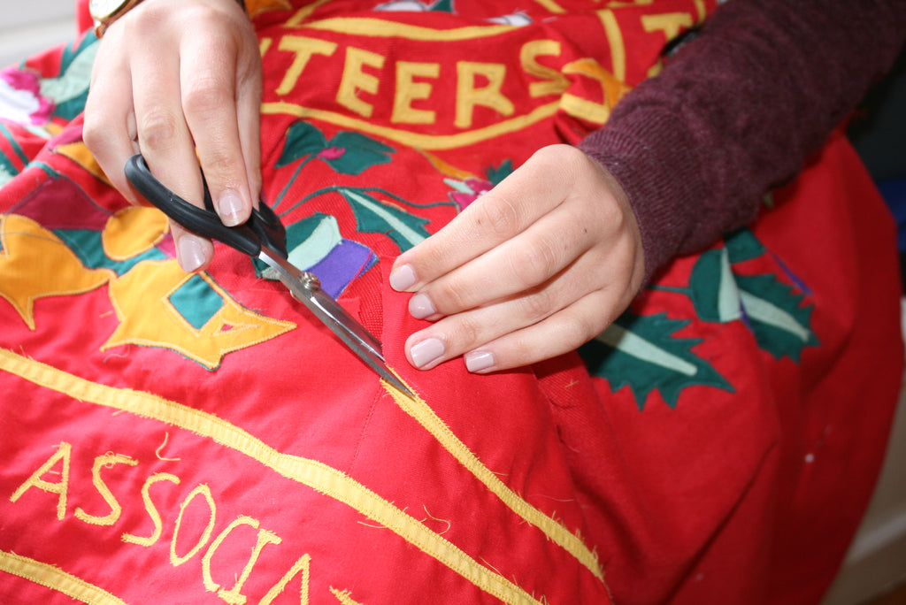 Trimming a stitched flag by Red Dragon Flagmakers