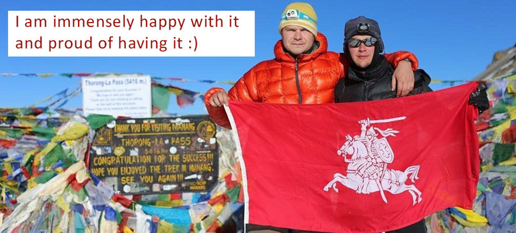 Mantas and his Luthuanian battle flag at Everest base camp.  A sewn flag made by Red Dragon flagmakers.