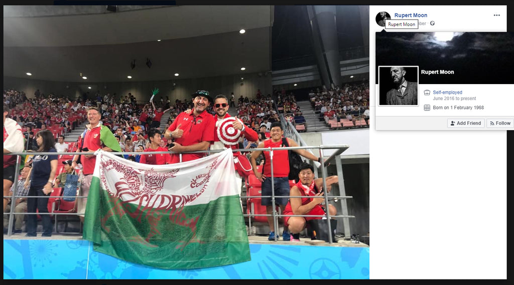 Rupert Moon with GRUFFCymru flag in Japan 2019 for Rugby World Cup by Red Dragon Flagmakers